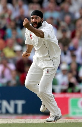 Panesar celebrates the wicket of Umar Gul