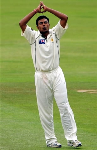 Danish Kaneria reacts after a near miss against Cook
