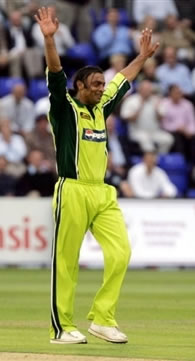 Shoaib Akhtar celebrates after taking the wicket of Clarke