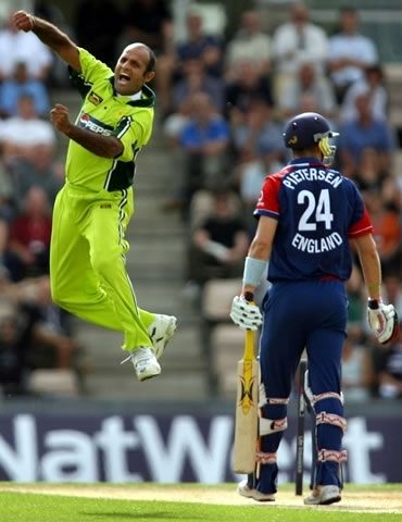 Neved-ul-Hasan celebrates the wicket of Pietersen