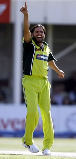 Shahid Afridi celebrates after taking a wicket