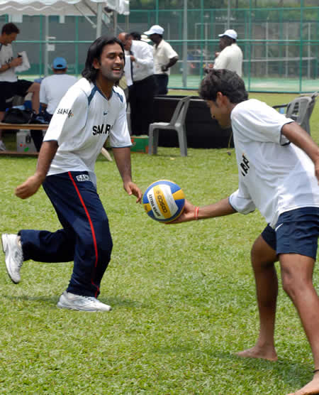 Dhoni plays football during training session