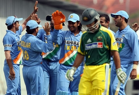 Indian team celebrates as Ponting walks back to the pavilion