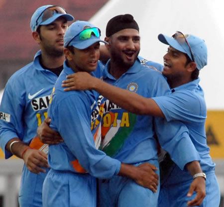 Harbhajan celebrates with teammates after taking a wicket