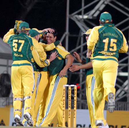 Australian players celebrate after taking a wicket