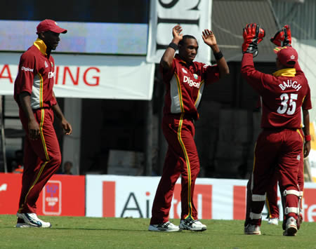 Bravo celebrates after taking a wicket