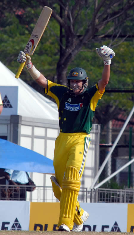Hussey raises his bat after his century