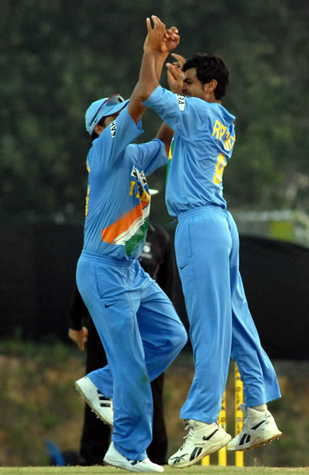 RP Singh celebrates after taking a wicket