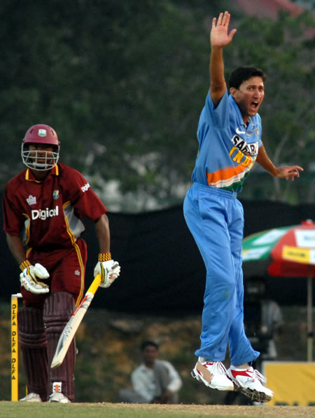 Agarkar celebrates after taking a wicket