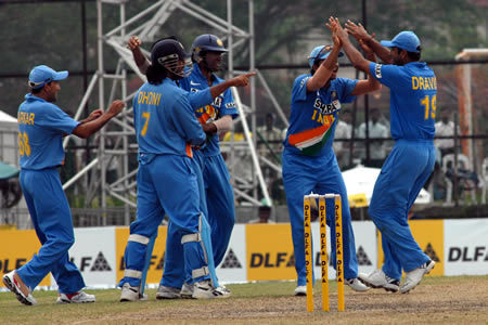 Indian players celebrate after getting a wicket