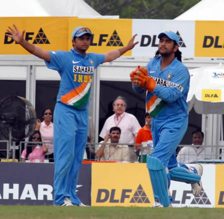 Dhoni and Raina celebrates after taking a wicket
