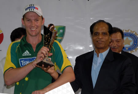 Brett Lee holds his