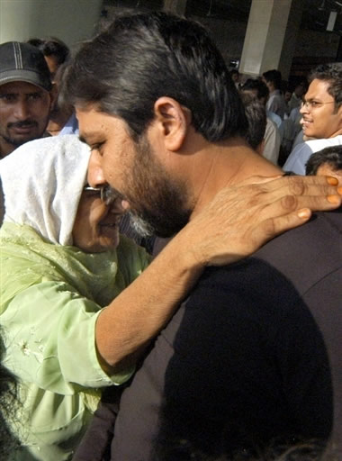 Inzamam-ul-Haq receives congratulations from an old woman supporter on his return from The Oval, London