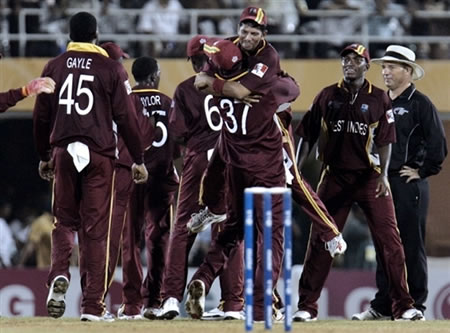West Indies cricketers celebrate their victory over Australia