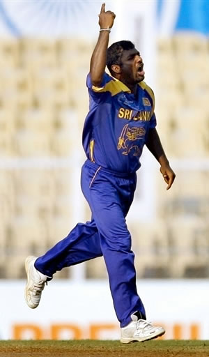 Muralitharan celebrates after taking a wicket
