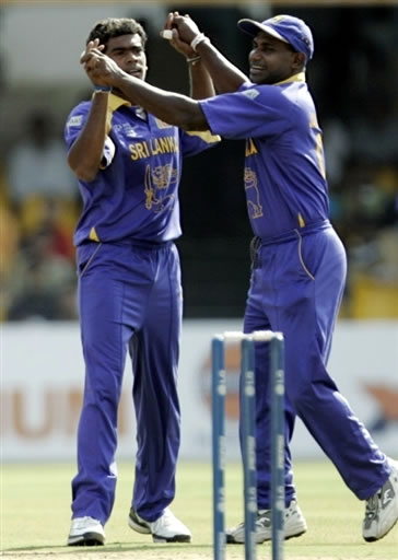 Malinga celebrates with Jayasuriya after taking a wicket