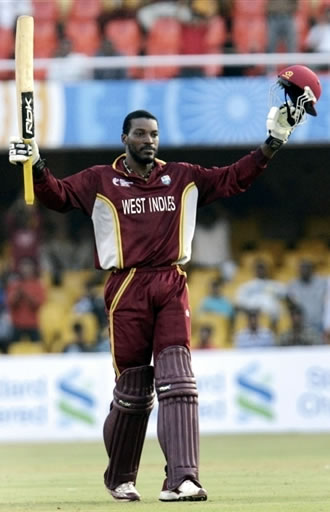 Gayle raises his bat after his century