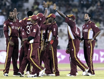 West Indies cricketers celebrate after taking a wicket