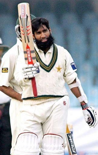 Mohammad Yousuf raises his bat after his century