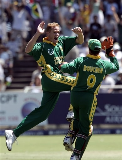 Pollock and Boucher celebrate the wicket of Sehwag