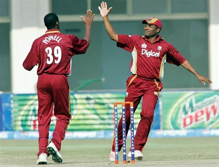 Powell and Lara celebrate the wicket of Faisal Iqbal