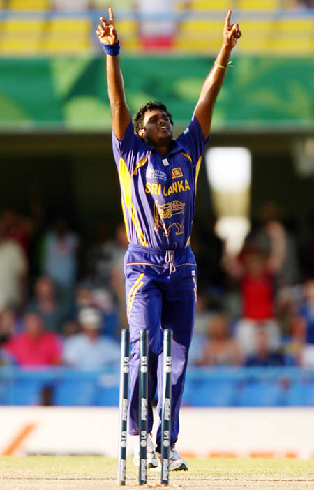 Dilhara Fernando celebrates taking the final wicket to give his team victory over England