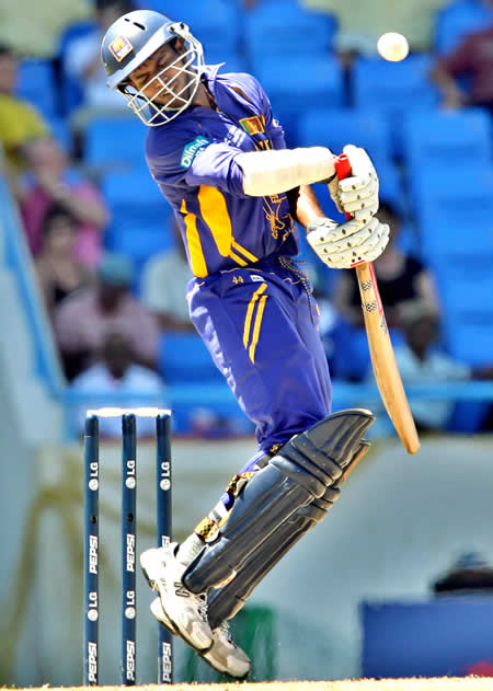 Upul Tharanga avoids a bouncer