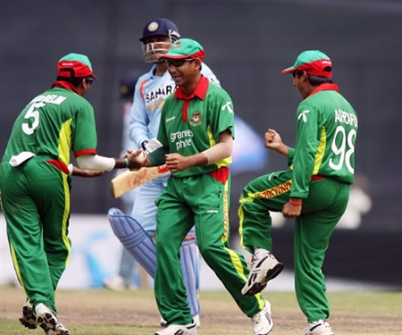Bangladesh players celebrate the dismissal of Virender Sehwag