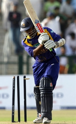 Chamara Kapugedera is bowled by Umar Gul