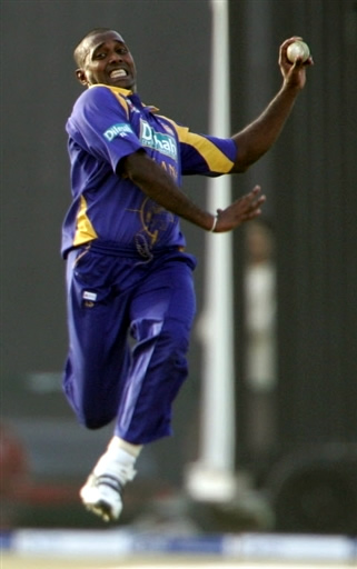 Ruchira Perera about to deliver a ball