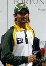 Shoaib Malik holds the winning trophy during the prize distribution ceremony