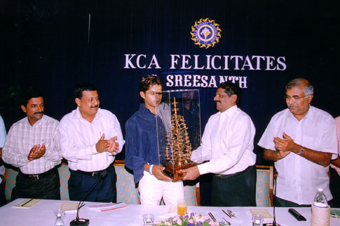 KCA president giving a memento