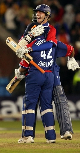 Stuart Broad celebrates with Ravi Bopara after hitting the winning runs