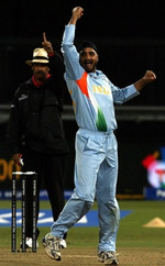 Harbhajan Singh celebrates after hitting the stumps in bowl-out against Pakistan