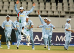 Indian players celebrate victory over Pakistan in bowl-out after thrilling tie