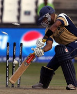 Navdeep Poonia is clean bowled by Umar Gul