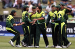 Shahid Afridi celebrates the wicket of Neil McCallum with is teammates
