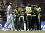 Pakistan team celebrates the dismissal of Yousuf Pathan