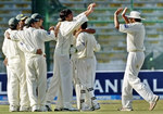 Mohammad Asif celebrates the wicket of Hashim Amla with his teammates