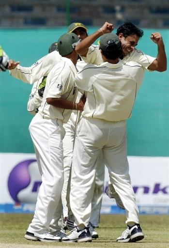 Abdur Rehman celebrates the wicket of Boucher