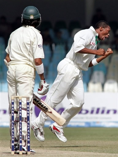Makhaya Ntini celebrates the wicket of Umar Gul