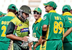 South Africa team celebrate the wicket of Afridi