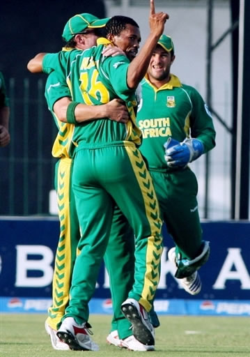 Makhaya Ntini celebrates the wicket of Kamran Akmal