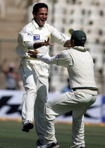 Yasir Arafat celebrates the wicket of Wasim Jaffer