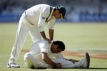 Yasir Arafat helps Shoaib Akhtar while he is feeling pain in his back