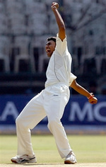 Danish Kaneria reacts after taking the wicket of Dravid