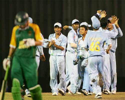 JD Vandiar walks away as the Indian players celebrate his wicket