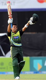 Kamran Akmal celebrates his hundred