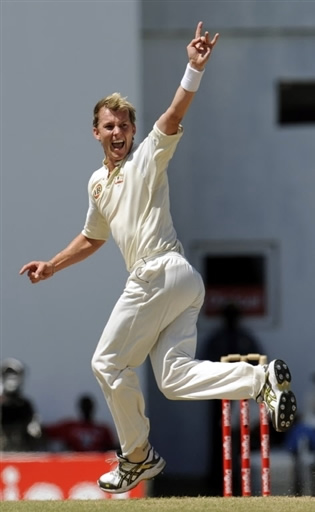 Brett Lee celebrates the wicket of Morton