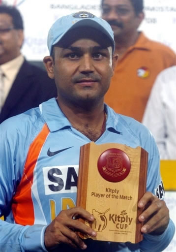 Virender Sehwag holds a Man of the Match trophy